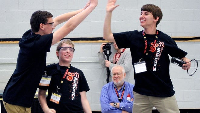The North Union Middle School robotics team of Matthew Millington, Conner Cox and Grant Daum celebrate a bracket win in the robot hockey competition at Thursday's National Robotics Challenge. About 1,100 students and their advisers are competing at the annual skills event running through Saturday at Veterans Memorial Coliseum.