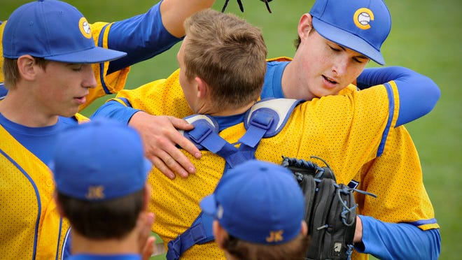 Cathedral's pitcher Jeff Fasching (right) hugs pitcher Thomas Imholte after beating Blake in the state quarterfinal game at Dick Putz Field on Thursday. Cathedral beat Blake 5-1.