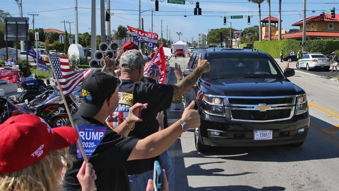President Trump and his motorcade pass by supporters on Southern Blvd. on the way to Mar-a-Lago Sunday afternoon.
