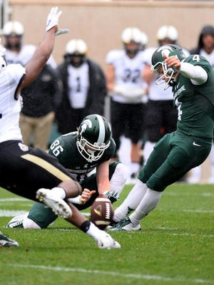 MSU kicker Michael Geiger hits his field goal late against Purdue to give MSU their 24th point at Spartan Stadium Saturday 10/3/2015. MSU won 24-21.