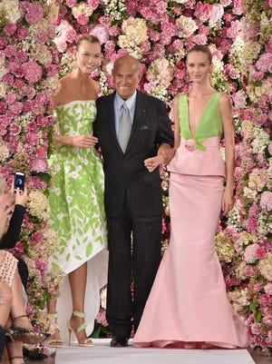 Designer Oscar de la Renta (center) and model Karlie Kloss (left) walk the runway at the Oscar De La Renta fashion show during Mercedes-Benz Fashion Week Spring 2015 on Sept. 9, 2014 in New York City.