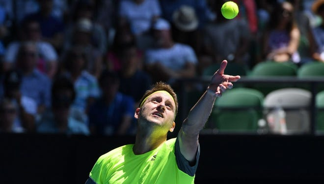 Tennys Sandgren is out at the Australian Open.