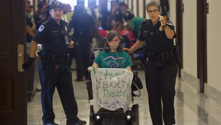 U.S. Capitol Police arrest a health care protester