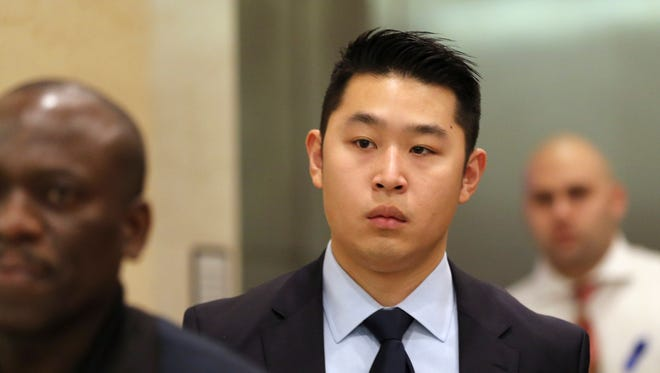 Police officer Peter Liang exits the courtroom during a break in closing arguments in his trial on charges in the shooting death of Akai Gurley.