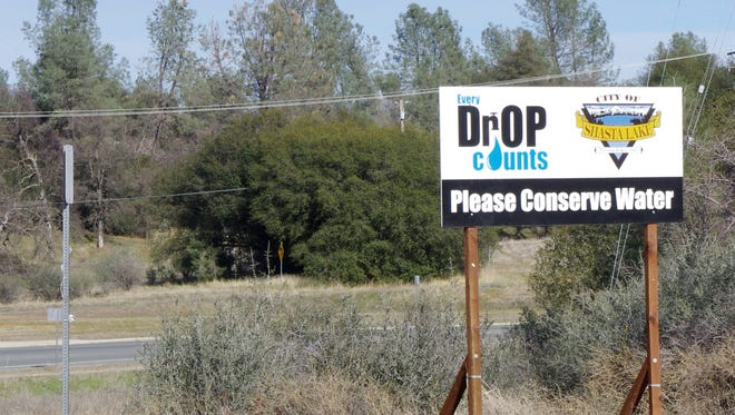 File photo - A sign along Pine Grove Avenue in Shasta Lake reminds residents to conserve water, an important issue during the last drought.