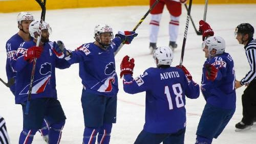 Stephane Da Costa, center, is congratulated after scoring a goal for France in the Hockey World Championships in May.