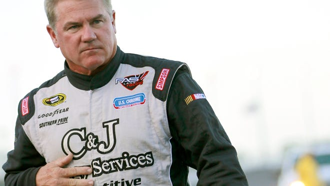 Terry Labonte walks to his car on pit road before the NASCAR Sprint Cup Series auto race at Daytona International Speedway, Saturday, July 7, 2012, in Daytona Beach, Fla. (AP Photo/John Raoux)