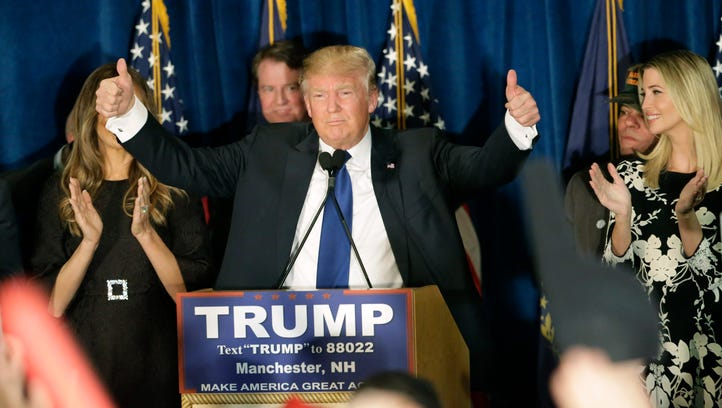 Donald Trump gives thumbs up to supporters during a
