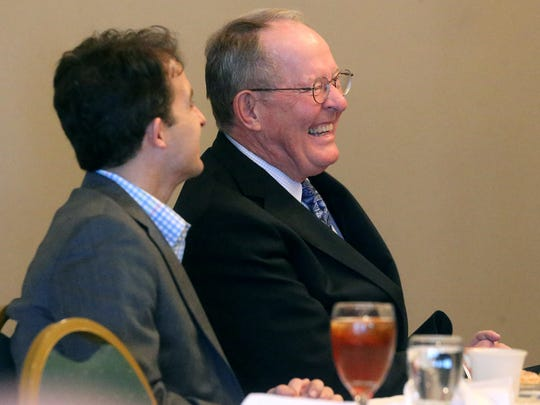 U.S. Sen. Lamar Alexander, right, laughs during the Murfreesboro Rotary lunch meeting Tuesday, Feb. 16, 2016, as the  senator sits next to Murfreesboro Mayor Shane McFarland, who introduced him.