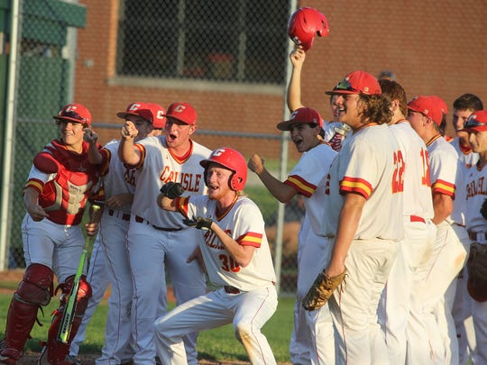 Carlisle players wait at home plate to greet senior Jordan Pierce after his home run. Carlisle beat Bondurant-Farrar 10-8 in a Class 3A substate final at Saydel High School on July 20 to advance to the state tournament.