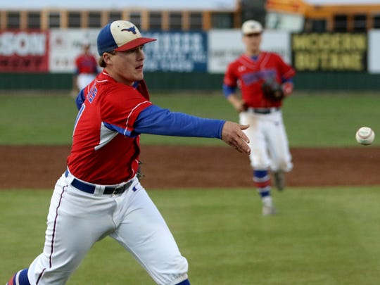 Graham pitcher Dillon Rodgers tosses the ball to first