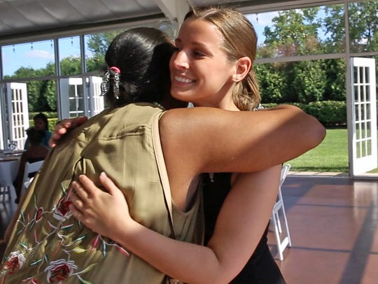 Janice Williamson-Cox, from Dayspring, left, hugs Sarah