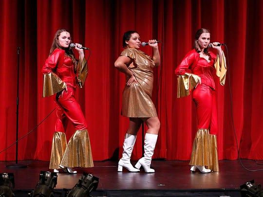 Jenna Roth, Zakia Trotter and Kiya Petik perform in
