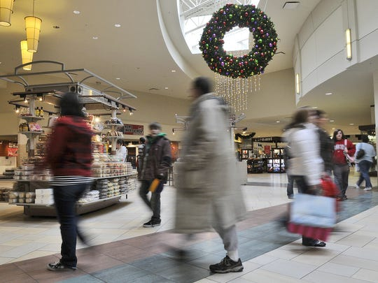 Shoppers whiz by in every direction, searching for Christmas gifts at Crossroads Center.