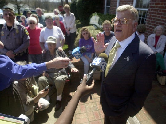 After keeping investors waiting several hours in Pickens, Carolina Investors, Inc. chairman of the board Earle Morris fielded questions from reporters and the public. on March 25, 2003.