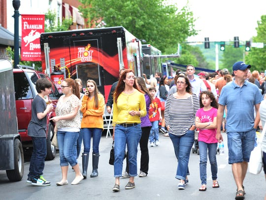 Walkers browse at the Eat the Street food truck festival