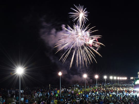 Thousands watch fireworks in Rehoboth Beach last year.