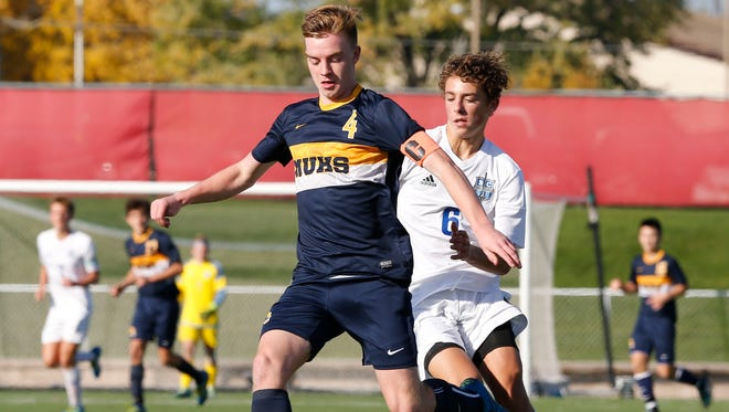 Marquette's Ben Leas (left) is the boys soccer state player of the year.