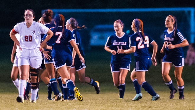 Millville celebrates a first half goal against Vineland at the Vineland Soccer Complex on Wednesday, September 20.