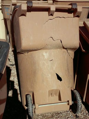 This damaged trash bin was replaced with a brand new one. If your bin is damaged, call Customer Service at 575-541-2111 to ask for a repair or replacement.