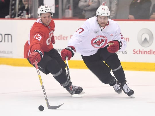 There's been a noticeable maturity on and off the ice from Pavel Zacha (37), right, at Devils practice at Prudential Center with defenseman Jocktan Chainey (73) on Sept. 16, 2017.