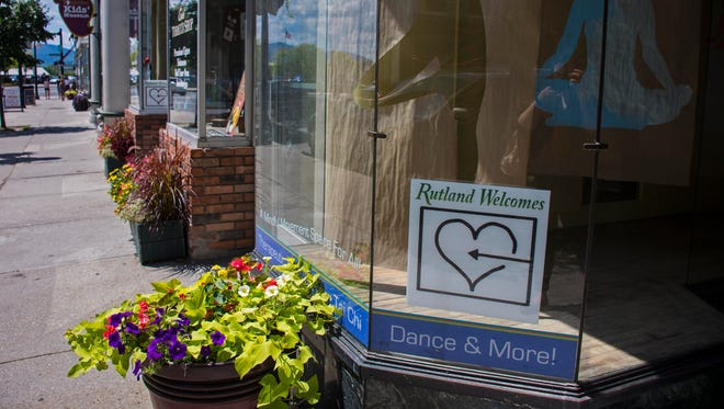"""A """"Rutland Welcome"""" sign and logo seen on Center Street in Rutland on Wednesday, July 27, 2016. Rutland Mayor Christopher Louras' proposal to bring 100 Syrian refugees to the city has caused some controversey."""
