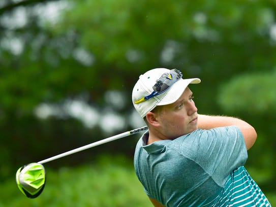 Chad Harbaugh follows through on a swing during the