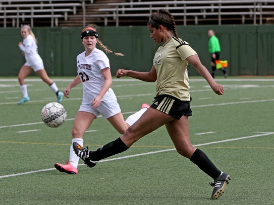 Rider's Jasmyn Montgomery passes in the match against