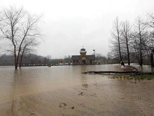 The Winton Woods boat house is unreachable after several days of rain made Winton Lake overflow at Winton Woods Park in Springfield Township Monday.