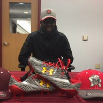 Markquese Bell celebrates his commitment to Maryland