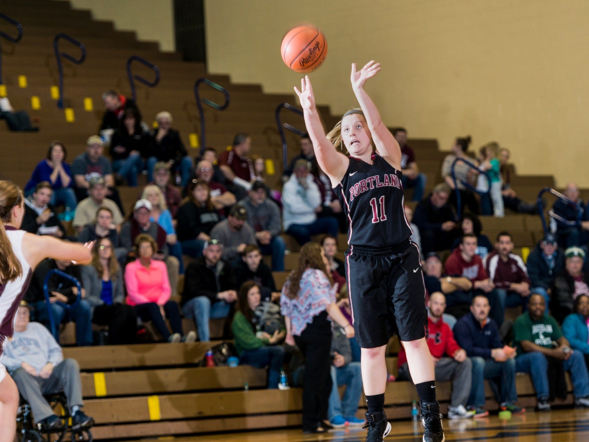 Jorie Rutkowski (11) of Portland shoots over an Eaton Rapids defender during their Class B regional semifinal Tuesday at Don Johnson Fieldhouse in Lansing.