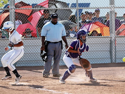 Rudy Gutirrez—El Paso Times Chapin's Kristal Andrade, left, steps on the plate as Eastlake catcher V. Brant waits for the throw during their game Friday at Eastlake.