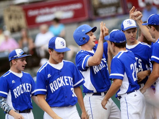 Spring Grove's Jonathan Sager high-fives teammates after scoring a run during the District 3 Class AAA baseball championship game at Santander Stadium in York on May 28. The Rockets lost to Donegal 11-5 in eight inning, but still qualified for the PIAA tournament.
