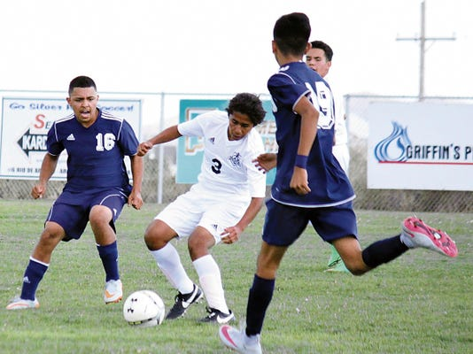 Danny Udero/Sun-News   Marco Narvaez (3) tries to split a few Deming defenders during Silver High's season opener at the Ben Altamirano Sports Complex.