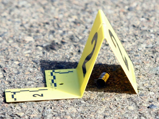 A bullet casing is marked at the scene of a deadly shooting at Umpqua Community College in Roseburg, Ore., Thursday, Oct. 1, 2015. (Michael Sullivan/The News-Review via AP)
