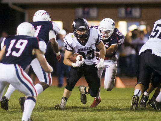South Western's Zach Hughes runs the ball Sept. 25 against New Oxford. South Western won the game.