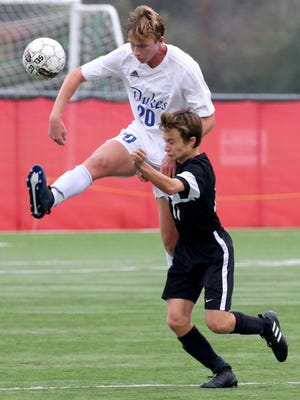 Whitefish Bay's Sam Marx and New Richmond's Andrew Johnson battle for control of the ball during WIAA Division 2 State semifinal play on Nov. 2. at Uihlein Soccer Park. Whitefish Bay defeated New Richmond 5-0.