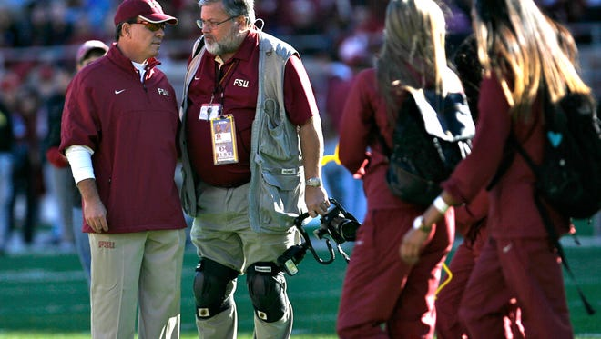Ryals Lee, seen here talking with FSU head coach Jimbo Fisher, has been a photographer fro Florida State for over 30 years.