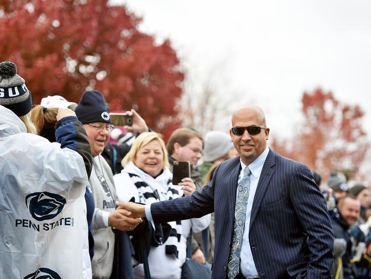 Penn State head football coach James Franklin greets