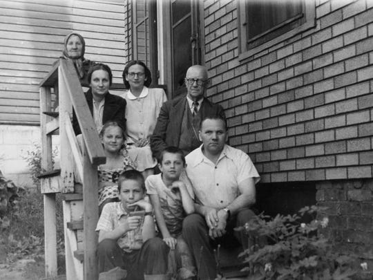 Ernest Brusubardis Sr. (upper right) is shown with his wife, Erna, and family on the porch of their home on Bettinger Court in Milwaukee after they arrived from Latvia in the late 1950s.