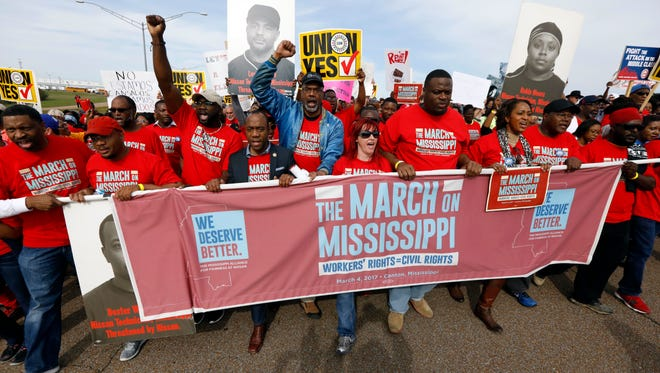 Thousands march to Nissan Motor Co.'s Canton, Miss., plant, following a pro-union rally in March 2017.