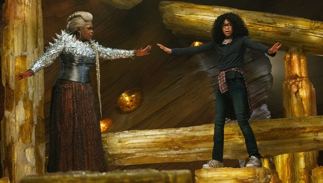 Oprah Winfrey as Mrs. Which and Storm Reid as Meg Murry in the Disney motion picture A WRINKLE IN TIME.