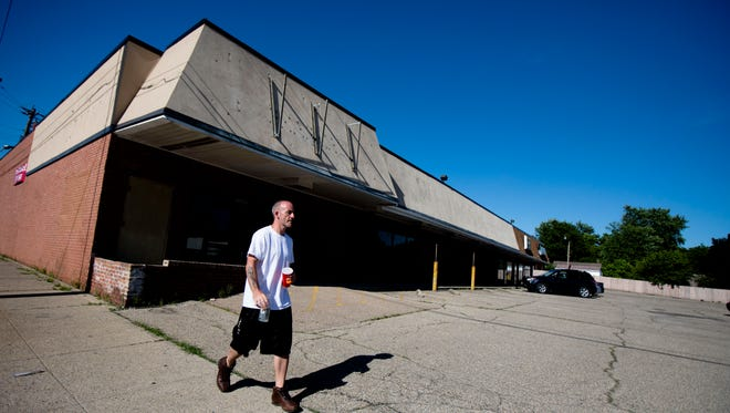 A man walks past a shopping center on Monday, June 4, 2018, in Hartwell, Ohio. Rev. Damon Lynch III has submitted a proposal for a Marijuana Dispensary in the shopping center at 8420 Vine Street. Lynch has been named eligible for provisional licenses to operate medical weed stores in Ohio. Lynch, pastor of New Prospect Baptist Church in Roselawn, and eight other investors backing Green Rx LLC, submitted a proposal for a 7,000-square-foot dispensary at 8420 Vine St. in Hartwell.