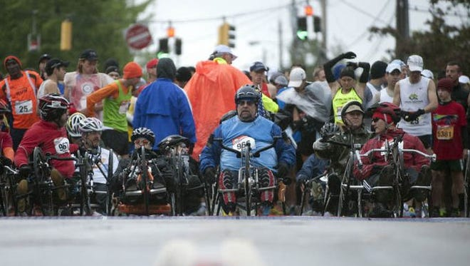 Handcyclists wait for the start of the race during the 25th KeyBank Vermont City Marathon on Sunday May 26, 2013 in Burlington.
