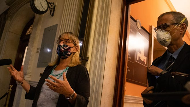 A clock on the corridor wall displayed the time - 4:20 a.m. - while Senate President Karen Spilka spoke to reporters outside the Senate Chamber early Tuesday morning, alongside Sen. William Brownsberger, after the branch passed a wide-ranging police reform bill during a marathon 16-hour session.