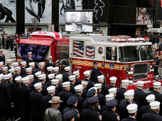 The body of firefighter Michael Davidson is brought