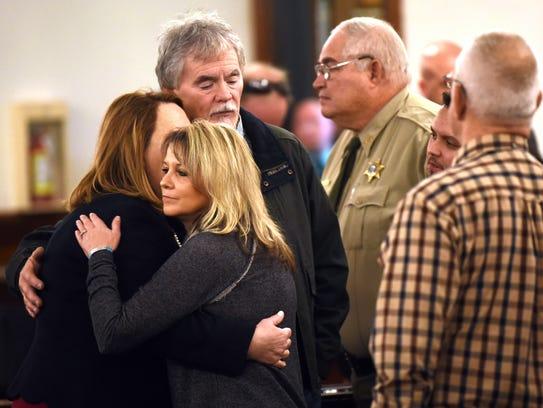 Dana and Karen Bobo embrace prosecutor Jennifer Nichols
