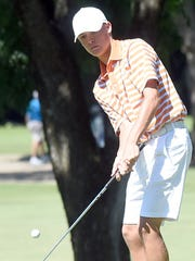 Gallatin 16-year-old Michael Barnard chips on to the
