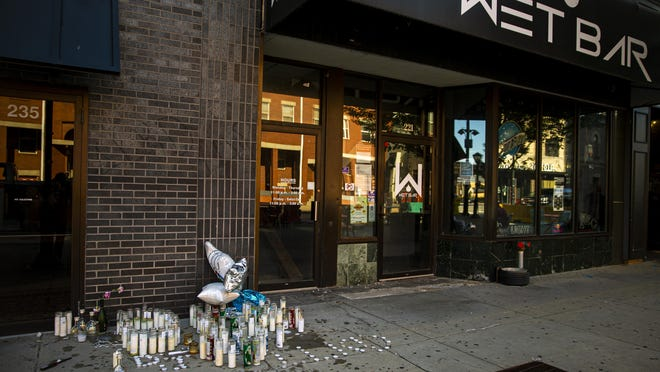 A memorial for Dearius Jones is left behind after a vigil was held for him outside of Wet Bar on Fifth Street where he was shot and later passed away after being taken to HSHS St. John's Hospital.