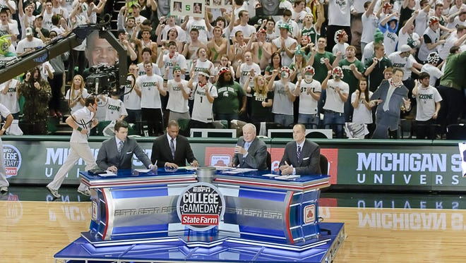 """Students fill the stands behind the set of ESPN's """"College GameDay"""" crew on Feb. 19, 2011, at the Breslin Center in East Lansing."""